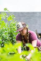 Young woman gardening along the Oregon Coast.