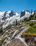 The Hound's Tooth (2819 meters) rises above Bugaboo Glacier in Bugaboo Provincial Park, in the Purcell Range of the Columbia Mountains, British Columbia, Canada. The Spires Trail to Conrad Kain Hut is 6 miles round trip with 2400 ft gain. This image was stitched from multiple overlapping photos.