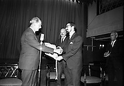 """24/07/1967<br /> 07/24/1967<br /> 24 July 1967<br /> First showing of """"Fleá Cheoil"""" at the Metropole Cinema, Dublin. A presentation was made to the director of the film Mr. Louis Marcus, for winning the Silver Bear Award at the Berlin International Film Festival, by Taoiseach Jack Lynch TD, on behalf of the Cork Film Society, where Mr. Marcus began his carrier. President of the Society Mr. Sean Hendrick attended the presentation. Taoiseach Jack Lynch making the presentation to Louis Marcus with Donal O Móráin, Ceannasai Gael-Linn in the centre."""