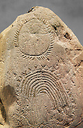 """Prehistoric  petroglyphs, rock carvings, of geometric designs carved by the the prehistoric Camuni people in the Copper Age around the 3rd milleneum BC, Stele """"Bagnolo 2"""" found in 1972 from Malegno near Bangnolo Ceresolo. Museo Nazionale della Preistoria della Valle Camonica ( National Museum of Prehistory in Valle Cominca ), Lombardy, Italy. Grey Art Background .<br /> <br /> If you prefer you can also buy from our ALAMY PHOTO LIBRARY  Collection visit : https://www.alamy.com/portfolio/paul-williams-funkystock/valcamonica-menhir-museum.html<br /> Visit our PREHISTORIC PLACES PHOTO COLLECTIONS for more  photos to download or buy as prints https://funkystock.photoshelter.com/gallery-collection/Prehistoric-Neolithic-Sites-Art-Artefacts-Pictures-Photos/C0000tfxw63zrUT4"""