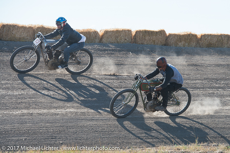 EBay Jake on 1919 Harley-Davidson racer riding just above Billy Lane on his 1919 Harley-Davidson in the Sons of Speed banked dirt oval racing at the Full Throttle Saloon during the annual Sturgis Black Hills Motorcycle Rally. Sturgis, SD. USA. Thursday August 10, 2017. Photography ©2017 Michael Lichter.
