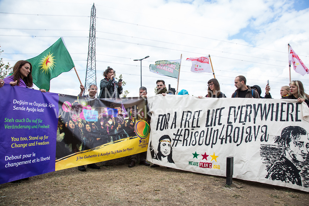 London, UK. 7 September, 2019. Kurdish solidarity activists take part in a sixth day of Stop The Arms Fair protests outside ExCel London against DSEI, the world's largest arms fair. The sixth day of protests was billed as a Festival of Resistance and included performances, entertainment for children and workshops as well as activities intended to disrupt deliveries to ExCel London for the arms fair.