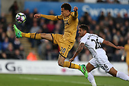 Dele Alli of Tottenham Hotspur controls the ball ahead of Kyle Naughton of Swansea city. Premier league match, Swansea city v Tottenham Hotspur  at the Liberty Stadium in Swansea, South Wales on Wednesday 5th April 2017.<br /> pic by Andrew Orchard, Andrew Orchard sports photography.