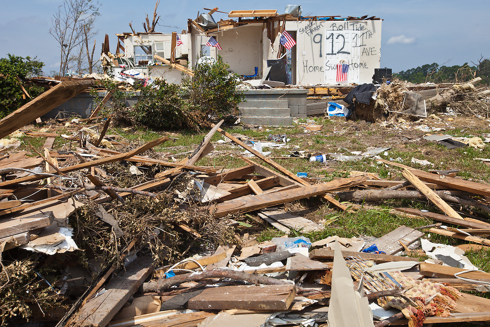 Home totaled by a tornado in Alabama marked with the name of an insurance company and decorated with American flags in Pleasant Grove, a suburb of Birmingham<br />  Alabama. 2011-05-12