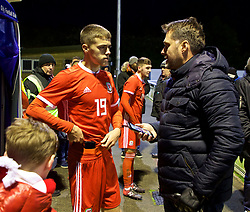 BANGOR, WALES - Tuesday, November 20, 2018: Wales' Lewis Collins speaks with a family member after a 2-0 victory over San Marino in the UEFA Under-19 Championship 2019 Qualifying Group 4 match between Wales and San Marino at the Nantporth Stadium. (Pic by Paul Greenwood/Propaganda)