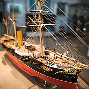A model of the armored corvette, Vasco da Gama, a 2422-ton combined propulsion ship launched in 1875 and serving the Portuguese colonies in Asia. She continued in service in various capacities until being decommisioned and scrapped in 1936. The Museu de Marinha (Maritime Museum of Navy Museum) focuses on Portuguese maritime history. It features exhibits on Portugal's Age of Discovery, the Portuguese Navy, commercial and recreational shipping, and, in a large annex, barges and seaplanes. Located in the Belem neighborhood of Lisbon, it occupies, in part, one wing of the Jerónimos Monastery. Its entrance is through a chapel that Henry the Navigator had built as the place where departing voyagers took mass before setting sail. The museum has occupied its present space since 1963.