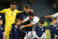 Dor Peretz (11) (Maccabi Tel Aviv)of Israel gives a mascot his top on a freezing night in Scotland for the UEFA Nations League match between Scotland and Israel at Hampden Park, Glasgow, United Kingdom on 20 November 2018.
