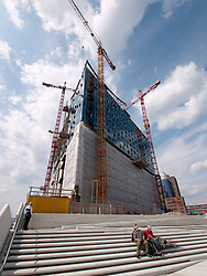 Construction of new Elbphilharmonie opera house beside Elbe River in Hafencity in Hamburg Germany