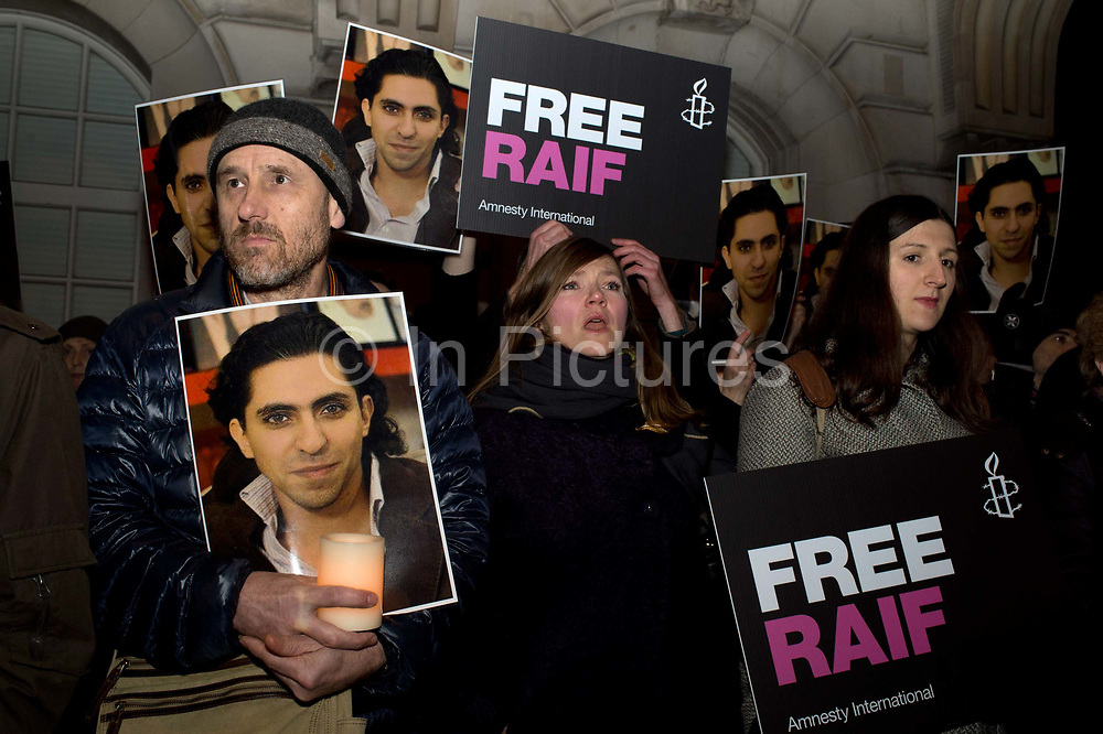 22.01.2015. Protest outside the Embassy of Saudi Arabia, in London, organized by Amnesty International, against the flogging and imprisonment of Raif Badawi.<br /> Raif has been sentenced to 10 years in prison and 1,000 lashes for running the website 'Saudi Arabian Liberals', which promoted debate and free speech.He received the first 50 lashes two weeks ago and is still recovering from them.