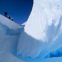 ANTARCTICA, Queen Maud Land. Alex Lowe, Jon Krakauer & Conrad Anker (MR) ski by crevasse in the Filchner Mountains.