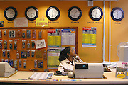 Mrs Diva, an employee at a Long distance call shop, Hackney, London.