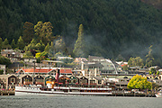 Waterfront of Lake Wakatipu, steamboat and town of Queenstown, South Island, New Zealand