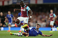 Gary Cahill of Chelsea intercepts Enner Valencia of West Ham United. Premier league match, Chelsea v West Ham United at Stamford Bridge in London on Monday 15th August 2016.<br /> pic by John Patrick Fletcher, Andrew Orchard sports photography.