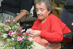 Woman arranging flowers,