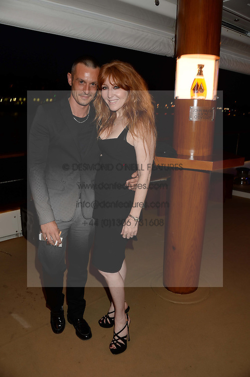 The Johnnie Walker Blue Label and David Gandy Drinks Reception aboard John Walker & Sons Voyager, St.Georges Stairs Tier, Butler's Wharf Pier, London, UK on 16th July 2013.<br /> Picture Shows:-Jonathan Saunders, Charlotte Tilbury,