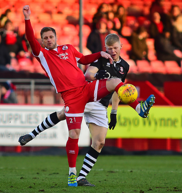 Lincoln City's Elliott Whitehouse vies for possession with Crawley Town's Dannie Bulman<br /> <br /> Photographer Andrew Vaughan/CameraSport<br /> <br /> The EFL Sky Bet League Two - Crawley Town v Lincoln City - Saturday 17th February 2018 - Broadfield Stadium - Crawley<br /> <br /> World Copyright © 2018 CameraSport. All rights reserved. 43 Linden Ave. Countesthorpe. Leicester. England. LE8 5PG - Tel: +44 (0) 116 277 4147 - admin@camerasport.com - www.camerasport.com