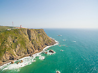 Sea view of lighthouse at Cabo da Roca cape, westernmost extent of mainland Portugal and continental Europe.