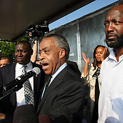 Martin family attorney Benjamin Crump (left), the  Reverend Al Sharpton (center) and Trayvon Martin's father Tracy Martin (right) speak onstage  during a rally for the shooting of Trayvon Martin on Thursday, March 22, 2012 at Fort Mellon Park in Sanford, Florida. (AP Photo/Alex Menendez) Trayvon Martin rally in Sanford, Florida.