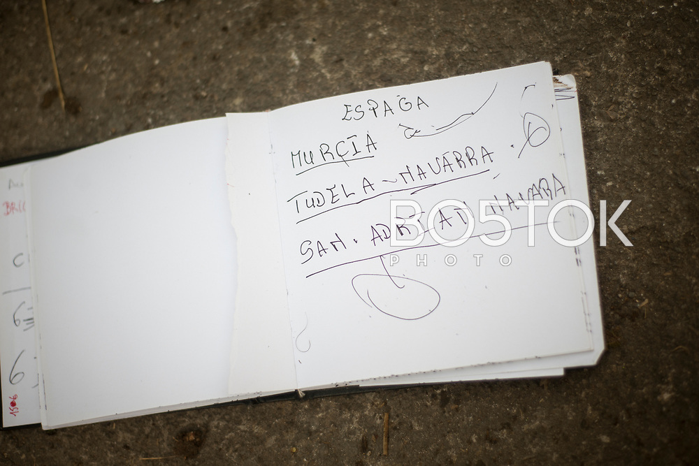 A notebook a migrant left behind, with notes about the journey. Lakaxita. Irun (Basque Country). October 10, 2018. Lakaxita is a self-managed socio-cultural space located in an occupied house, where volunteers have created a hosting network for migrants in transit who have already completed the 5-day period that can remain in public resources. This group of volunteers is avoiding a serious humanitarian problem Irún, the Basque municipality on the border with Hendaye. As the number of migrants arriving on the coasts of southern Spain incresead, more and more migrants are heading north to the border city of Irun. (Gari Garaialde / Bostok Photo)