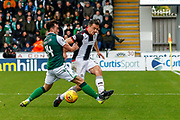 Stephen McGinn of St Mirren gets tackled by Stephen Mallan of Hibernian FC during the Ladbrokes Scottish Premiership match between St Mirren and Hibernian at the Simple Digital Arena, Paisley, Scotland on 29th September 2018.