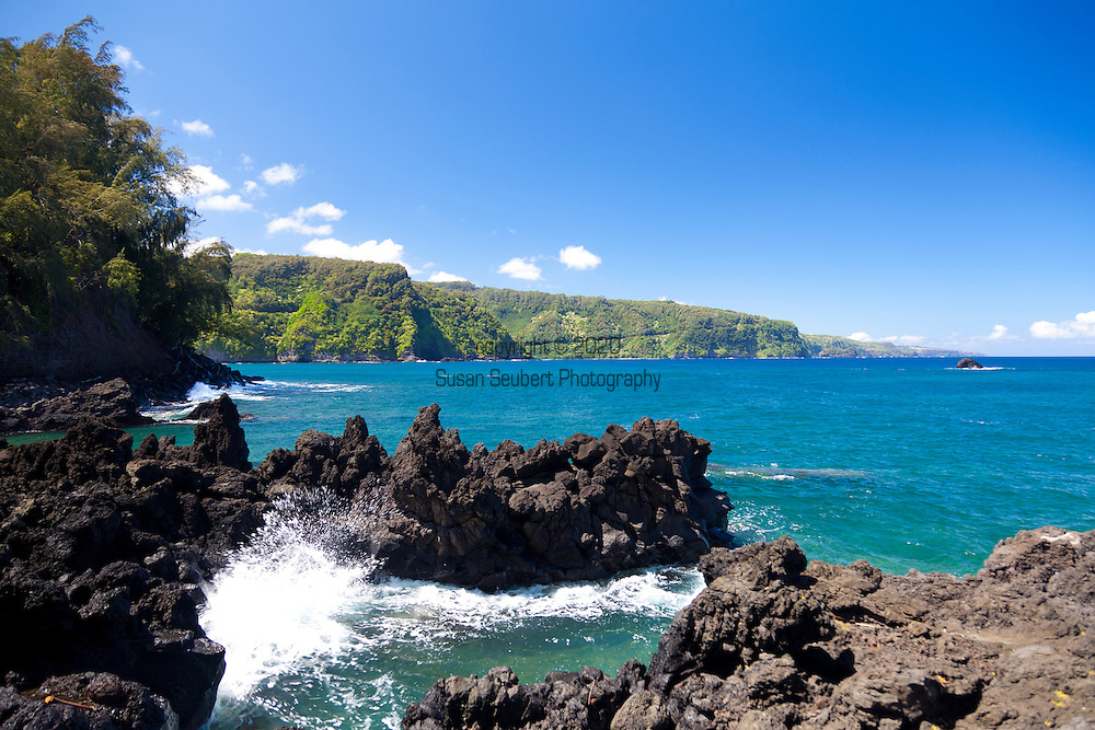 Maui, Hawaii.  The Keanae Peninsula where rough, black lava meets the gorgeous, blue ocean.  Home to a small community of Taro farmers.  From here, one can look back at the road cut into the unfolding cliffs of East Maui.
