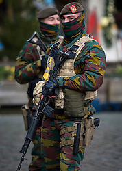 """© Licensed to London News Pictures. 23/11/2015. Brussels, Belgium. Belgian military patrolling The Grand Place, the main square in central Brussels where the city is currently on lockdown amid """"imminent threat"""" of Paris-style bomb and gun attacks. Some public transport and schools have been closed as a precaution. Photo credit: Ben Cawthra/LNP"""