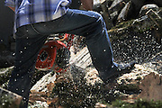 Cutting firewood with a power saw