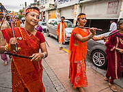 05 OCTOBER 2014 - GEORGE TOWN, PENANG, MALAYSIA:  Women dance and pray during a procession honoring Durga in George Town during the Navratri procession. Navratri is a festival dedicated to the worship of the Hindu deity Durga, the most popular incarnation of Devi and one of the main forms of the Goddess Shakti in the Hindu pantheon. The word Navaratri means 'nine nights' in Sanskrit, nava meaning nine and ratri meaning nights. During these nine nights and ten days, nine forms of Shakti/Devi are worshiped.   PHOTO BY JACK KURTZ