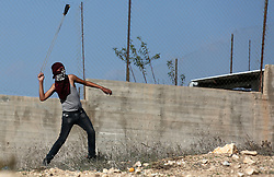 November 19, 2018 - Nablus, West Bank, Palestinian Territory - Palestinian protesters clash with Israeli forces, in the West Bank village of Urif, near Nablus. (Credit Image: © Shadi Jarar'Ah/APA Images via ZUMA Wire)