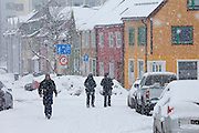 Locals walking in the snow in Tromso within the Arctic Circle in Northern Norway
