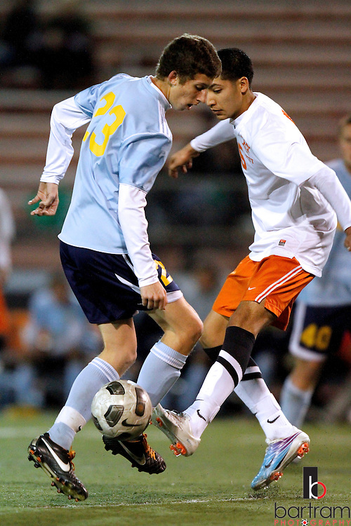 Heritage High's Joshua Morton, left, and Pittsburg High's Michael Gonzalez fight for control of the ball during their game at Pittsburg High School on Tuesday, January 10, 2012. (Photo by Kevin Bartram).