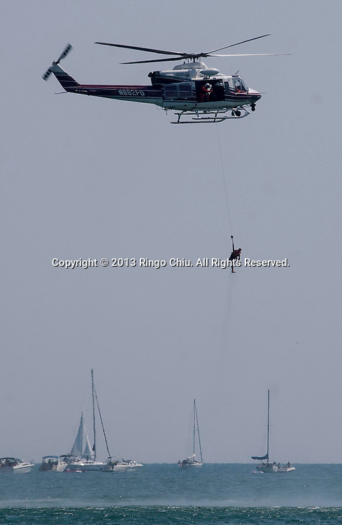 A Chicago Fire Department helicopter performs above Lake Michigan during the Chicago Air and Water Show Sundayday, Aug. 18, 2013 in Chicago, Illinois. (Photo by Ringo Chiu/PHOTOFORMULA.com)