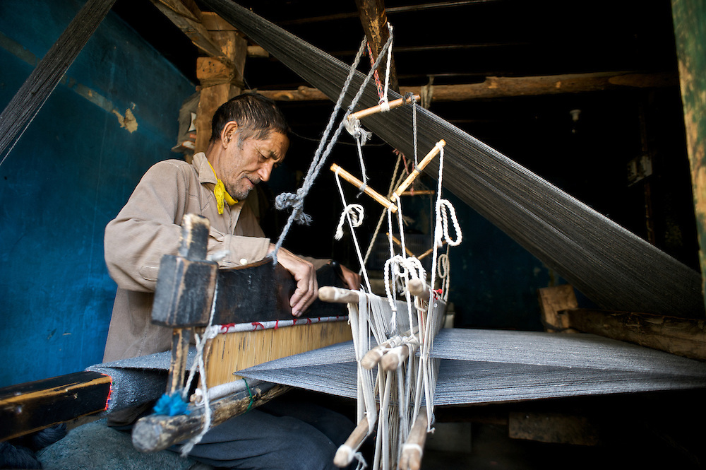 A Kinnauri man in the village of Giabong, Himachal Pradesh, in the process of making a rug.