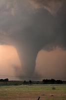 A tornado churns in a field near Rozel, Kansas, May 18, 2013.