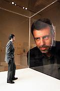 John S. Weber looking at a model of himself by German artist Karin Sander. Museum Of Modern Art (MOMA) San Francisco, California. USA. MODEL RELEASED.