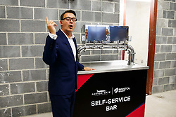 Bristol Sport CEO Andrew Billingham demonstrates a state of the art self service bar as Lansdown Club Members are given a preview of the Heineken Lounge and other facilities in the newly built South Stand - Mandatory byline: Rogan Thomson/JMP - 07966 386802 - 13/08/2015 - SPORT - Ashton Gate Stadium - Bristol, England - Bristol Sport Lansdown Club Networking Event.
