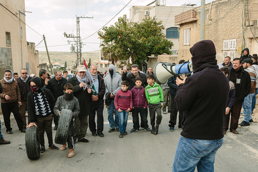 Murad Shteiwi (L), speaks to the crowd as he leads a weekly demonstration against the expropriation of Palestinian land by Israel and against the closure of the main road leading to Nablus, in the Palestinian village of Kufr Qaddum, West Bank, on February 21, 2020.