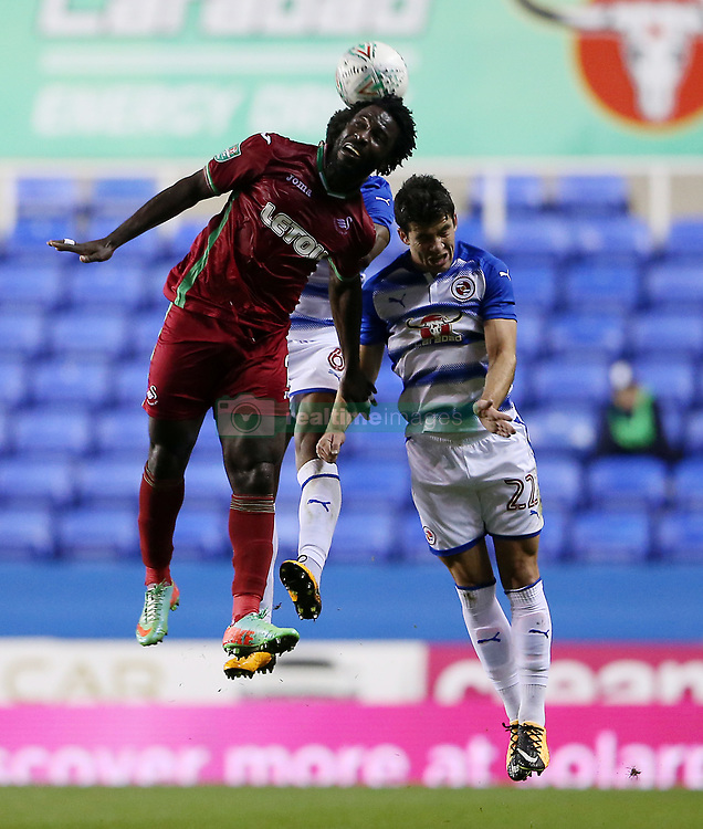 Swansea's Wilfried Bony wins a header against Reading's Pelle Clement during the Carabao Cup, third round match at the Madejski Stadium, Reading.
