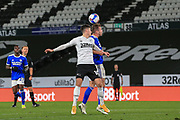 Cardiff City midfielder Joe Ralls (8) heads the ball as Tom Lawrence of Derby County (10)  closes in during the EFL Sky Bet Championship match between Derby County and Cardiff City at the Pride Park, Derby, England on 28 October 2020.