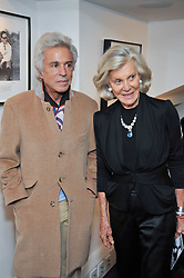 GIANCARLO GIAMMETTI and MARINA CICOGNA at a private view of photographs by Marina Cicogna from her book Scritti e Scatti held at the Little Black Gallery, 3A Park Walk London SW10 on 16th October 2009.