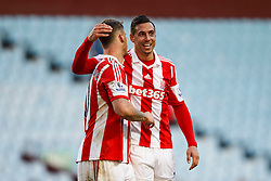 Stoke Goalscorer Stoke Marko Arnautovic (AUT) is hugged by Forward Marko Arnautovic (AUT) after a 1-4 victory - Photo mandatory by-line: Rogan Thomson/JMP - 07966 386802 - 23/03/2014 - SPORT - FOOTBALL - Villa Park, Birmingham - Aston Villa v Stoke City - Barclays Premier League.