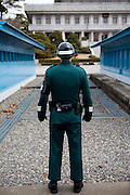 """A South Korean soldier at the Joint Security Area (JSA). The Joint Security Area or Panmunjom, often called the """"Truce Village""""  is the only portion of the Korean Demilitarized Zone (DMZ) where South and North Korean forces stand face-to-face. The area is used by the two Koreas for diplomatic engagements and, until March 1991, was also the site of military negotiations between North Korea and the United Nations Command (UNC). South Korea, Republic of Korea, KOR, 23rd of March 2010."""