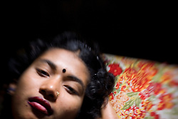 Sex worker Beauty, 18, is seen at brothel in Faridpur, Bangladesh. She has been working as a sex worker for 3 years.