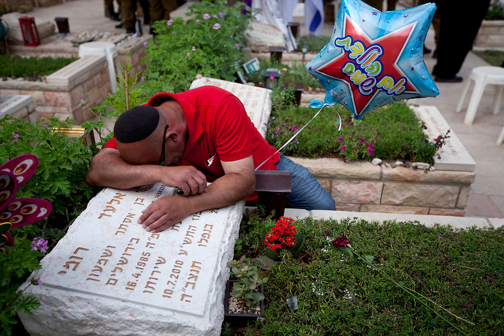 An Israeli man weeps over the grave of his son, a fallen IDF soldier, at the Mt. Herzl military cemetery in Jerusalem, on May 4, 2011. Israel will mark the annual Memorial Day for Fallen Soldiers next week.