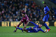 Raheem Sterling of Manchester city is tackled by Jazz Richards of Cardiff city. The Emirates FA Cup, 4th round match, Cardiff city v Manchester City at the Cardiff City Stadium in Cardiff, South Wales on Saturday 28th January 2018.<br /> pic by Andrew Orchard, Andrew Orchard sports photography.