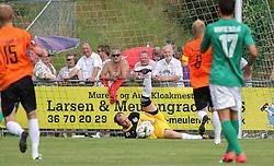 Mads Hamberg (FC Helsingør) med greb om bolden under kampen i 2. Division Øst mellem Boldklubben Avarta og FC Helsingør den 19. august 2012 i Espelunden. (Foto: Claus Birch).