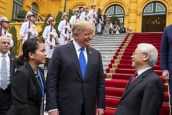February 27, 2019 - Hanoi, Vietnam - Vietnamese President NGUYEN PHU TRONG and U.S President DONALD TRUMP chat on departure from the Presidential Palace following the signing of Commercial Trade agreements in Hanoi, Vietnam. (Credit Image: © Shealah Craighead/The White House via ZUMA Wire)