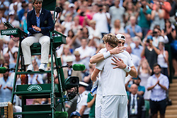 July 13, 2018 - London, England, UK - KEVIN ANDERSON (RSA) and JOHN ISNER (USA) hug after their semi-final match of the 2018 Wimbledon Championships, at the All England Lawn Tennis and Croquet Club. South African Anderson won the second-longest match in Wimbledon history by outlasting American Isner to reach the men's final. They slugged it out on Centre Court for six hours and 35 minutes before the eighth seed came through 7-6 (8-6) 6-7 (5-7) 6-7 (9-11) 6-4 26-24. (Credit Image: © Chaz Niell/Icon SMI via ZUMA Press)