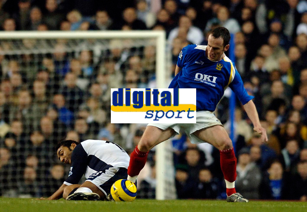 Photo: Daniel Hambury.<br />Tottenham Hotspur v Portsmouth. The Barclays Premiership. 12/12/2005.<br />Portsmouth's Andy O'Brian and Spurs' Mido battle for the ball.