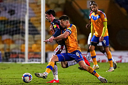 Ollie Clarke of Mansfield Town tussles with Kieran Lee of Bolton Wanderers - Mandatory by-line: Ryan Crockett/JMP - 17/02/2021 - FOOTBALL - One Call Stadium - Mansfield, England - Mansfield Town v Bolton Wanderers - Sky Bet League Two